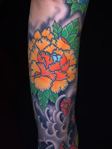 Asian style orange flower in sea tattoo for Japanese wave and flower tattoo