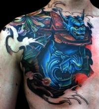 Blue samurai mask tattoo on chest